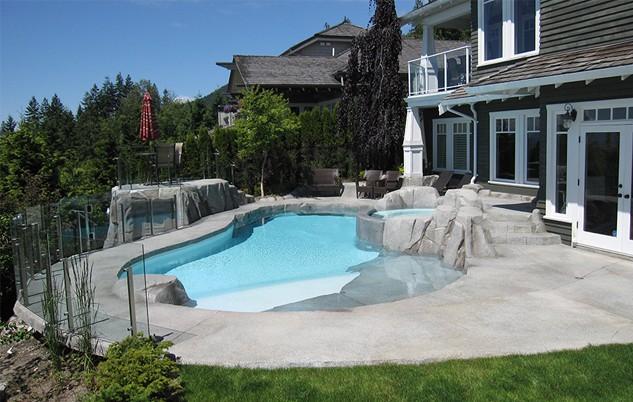Beautiful backyard renovation with swimming pool and hot tub