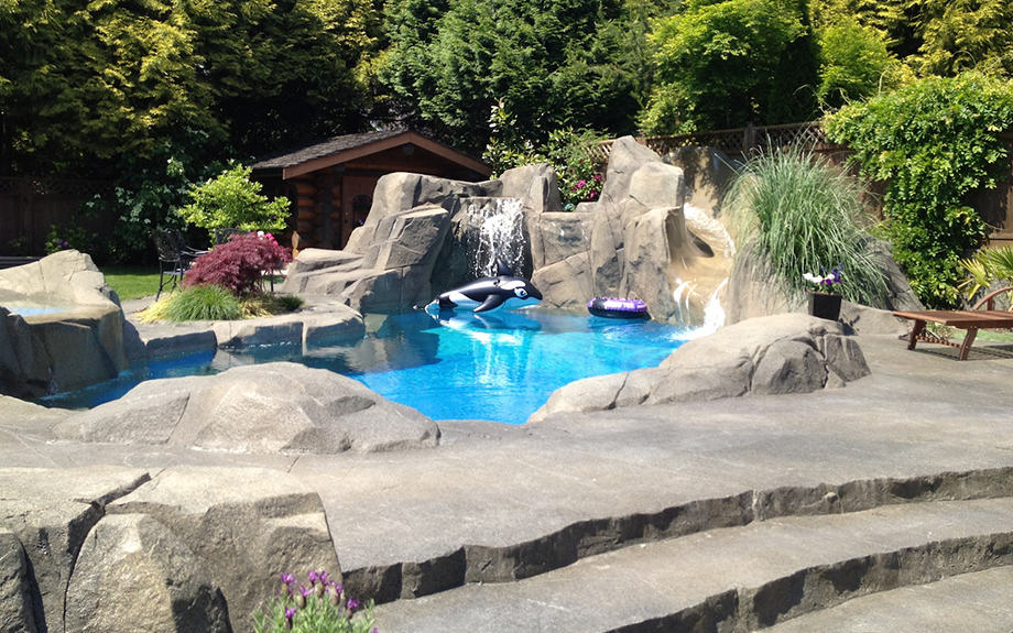 Backyard custom swimming pool with waterfal