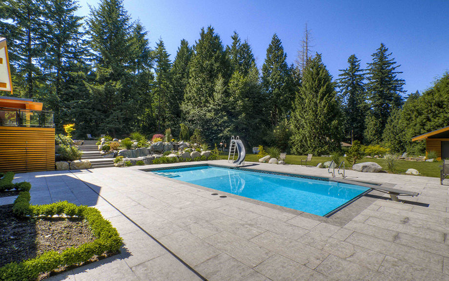 Custom concrete swimming pool with slide
