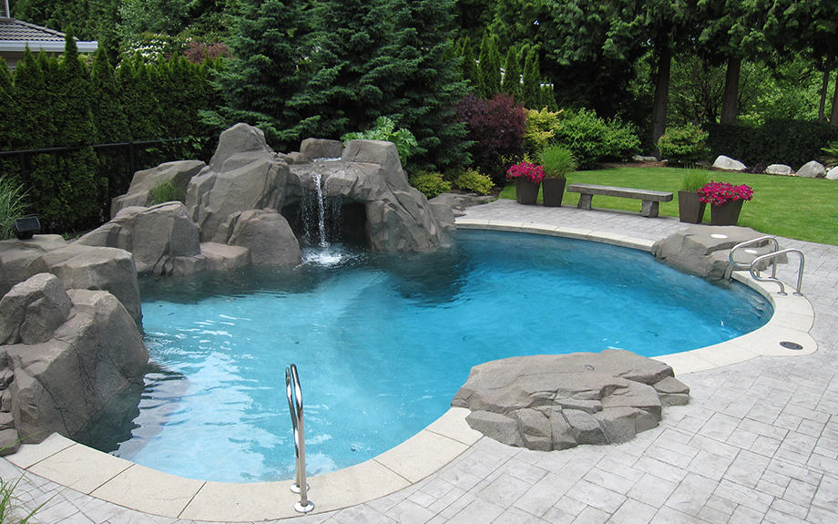 One of a kind luxury swimming pool with waterfall