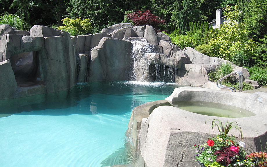 Private swimming pool with hot tub and waterfall