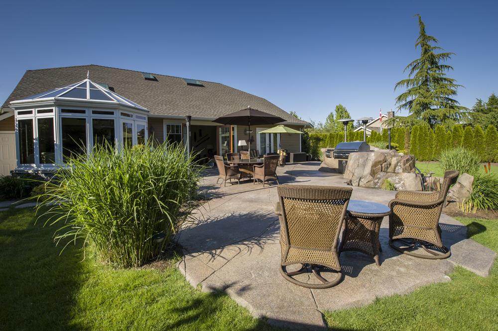 Custom designed backyard with natural concrete rock work