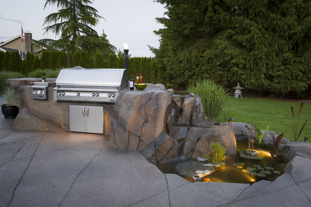 Stainless steel outdoor custom barbecue and pond