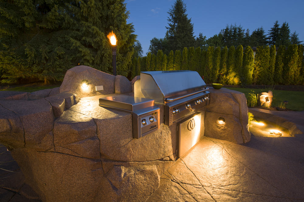 Custom outdoor barbecue at nightiime