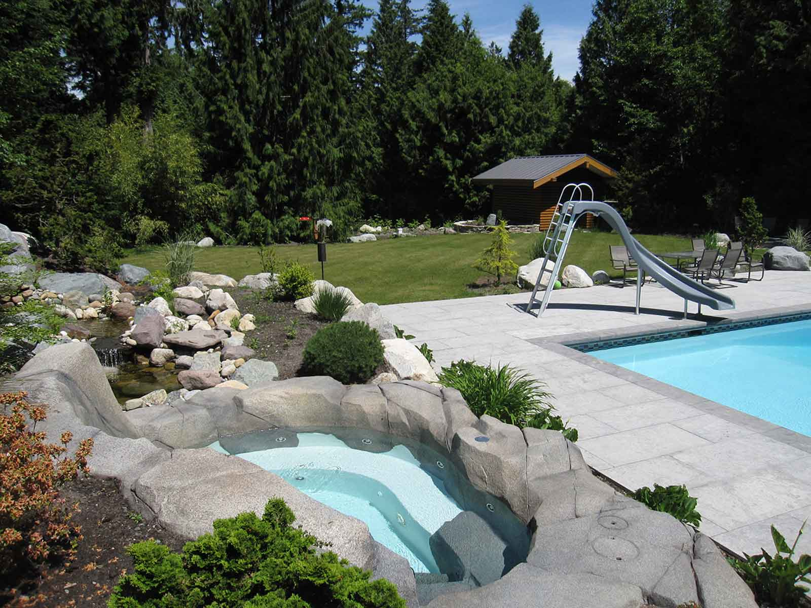 Custom designed backyard with swimming pool and hot tub