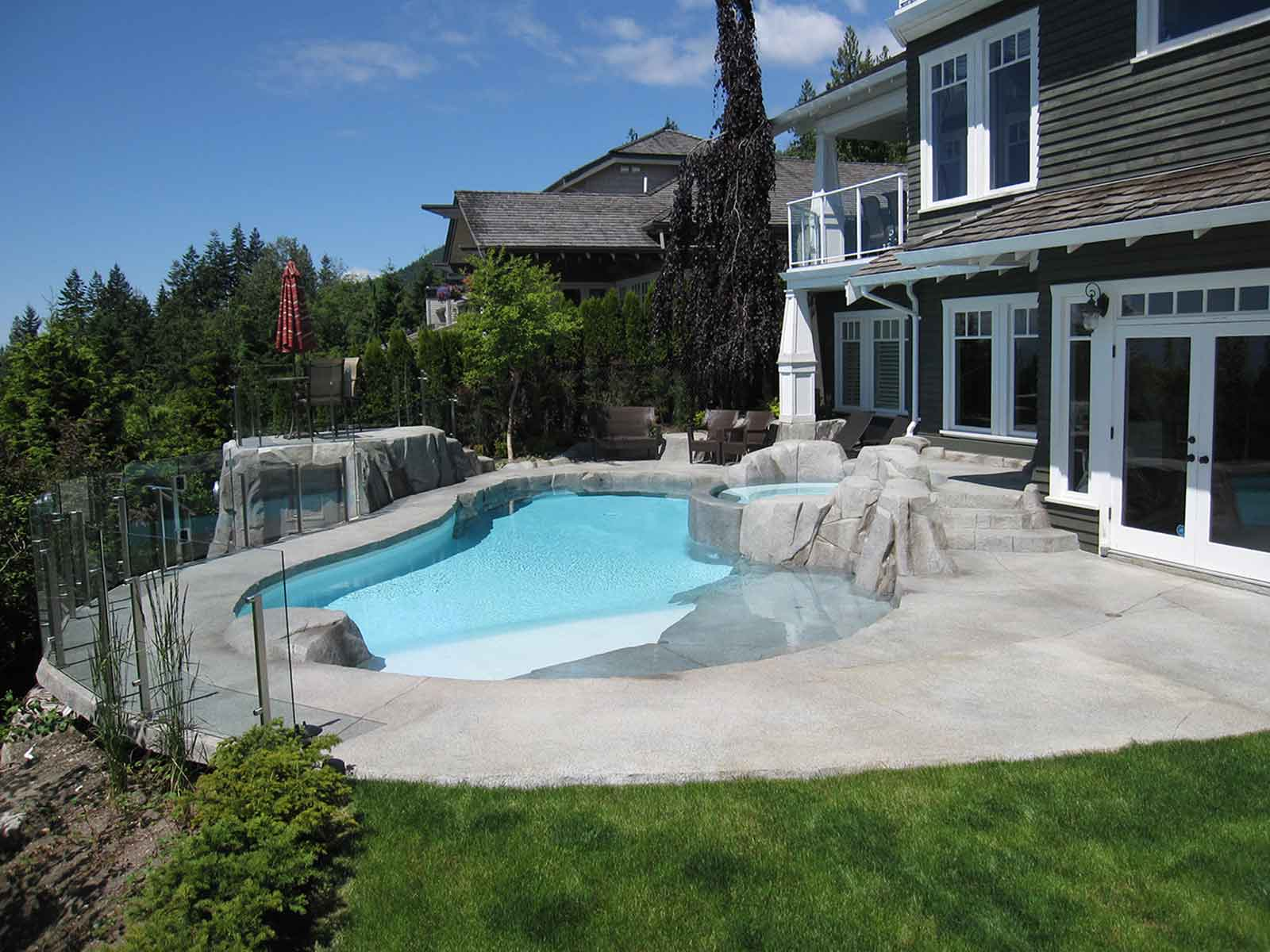 Backyard custom designed swimming pool and patio