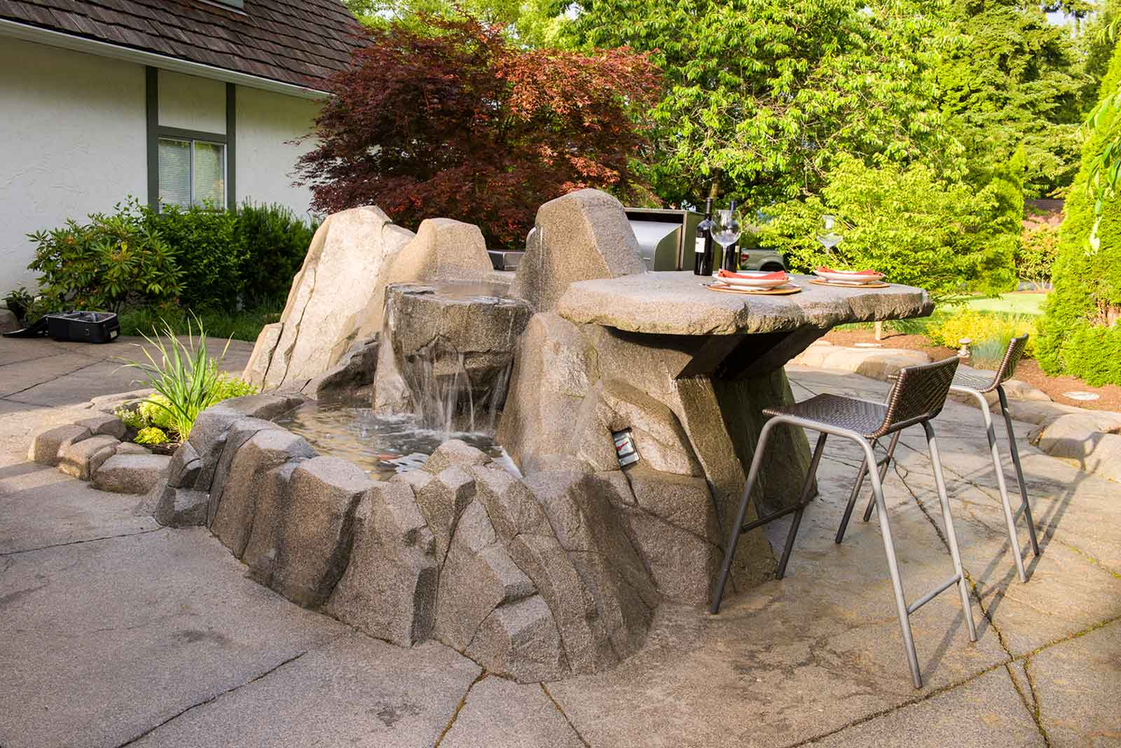 Concrete patio and artificial rock work