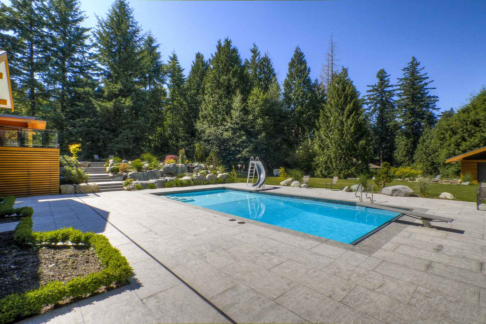 Pool with concrete paved deck