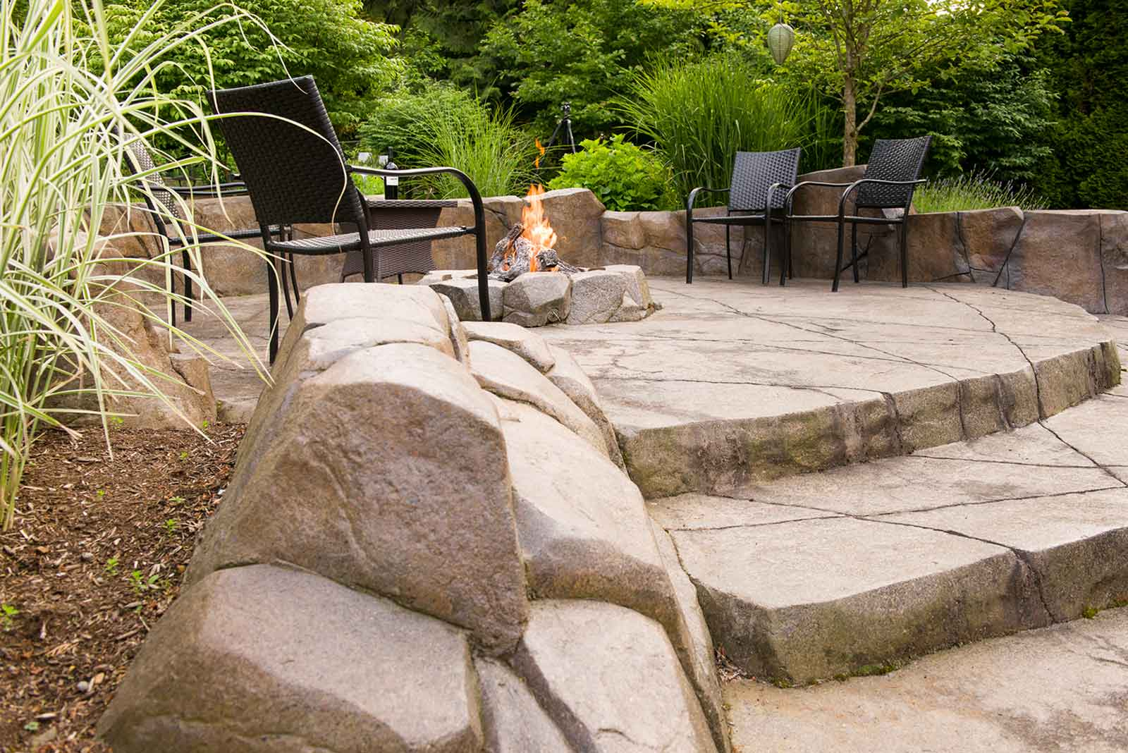Secluded backyard with concrete rock work