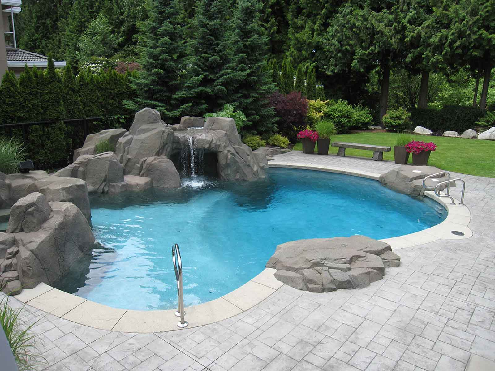 Concrete paved swimming pool deck