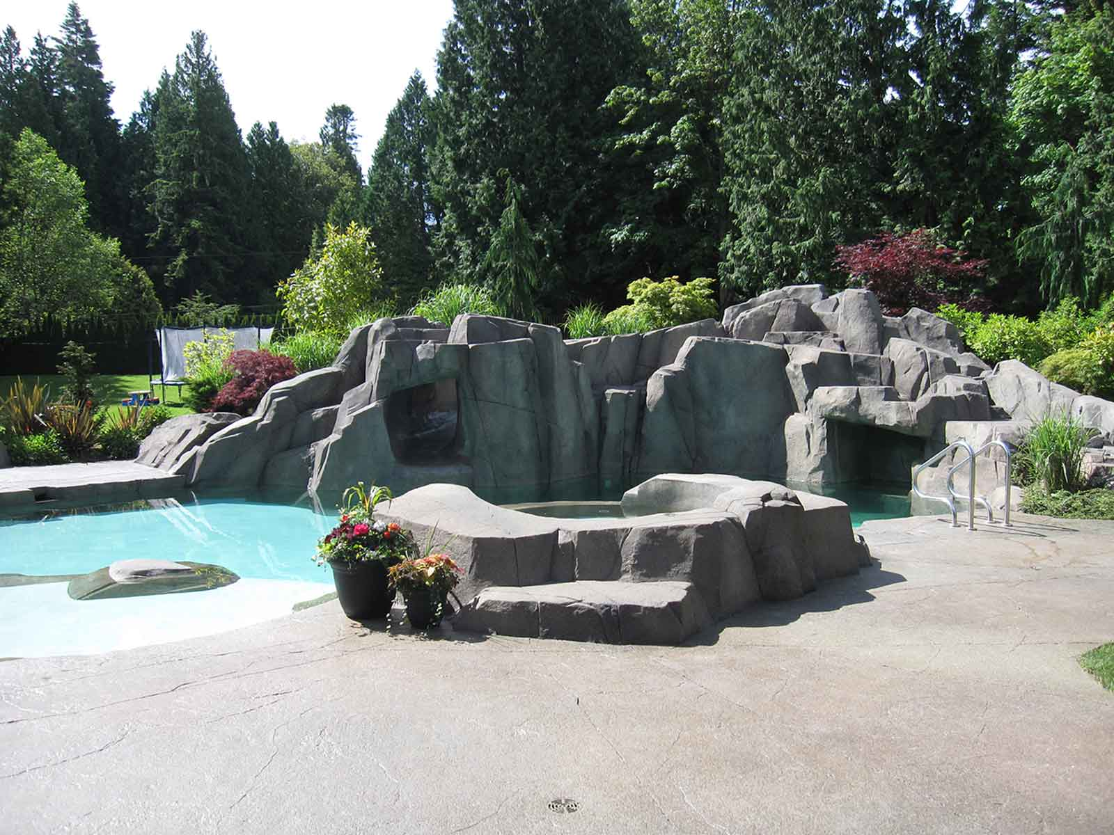 Custom artificial rock work and in-ground swimming pool
