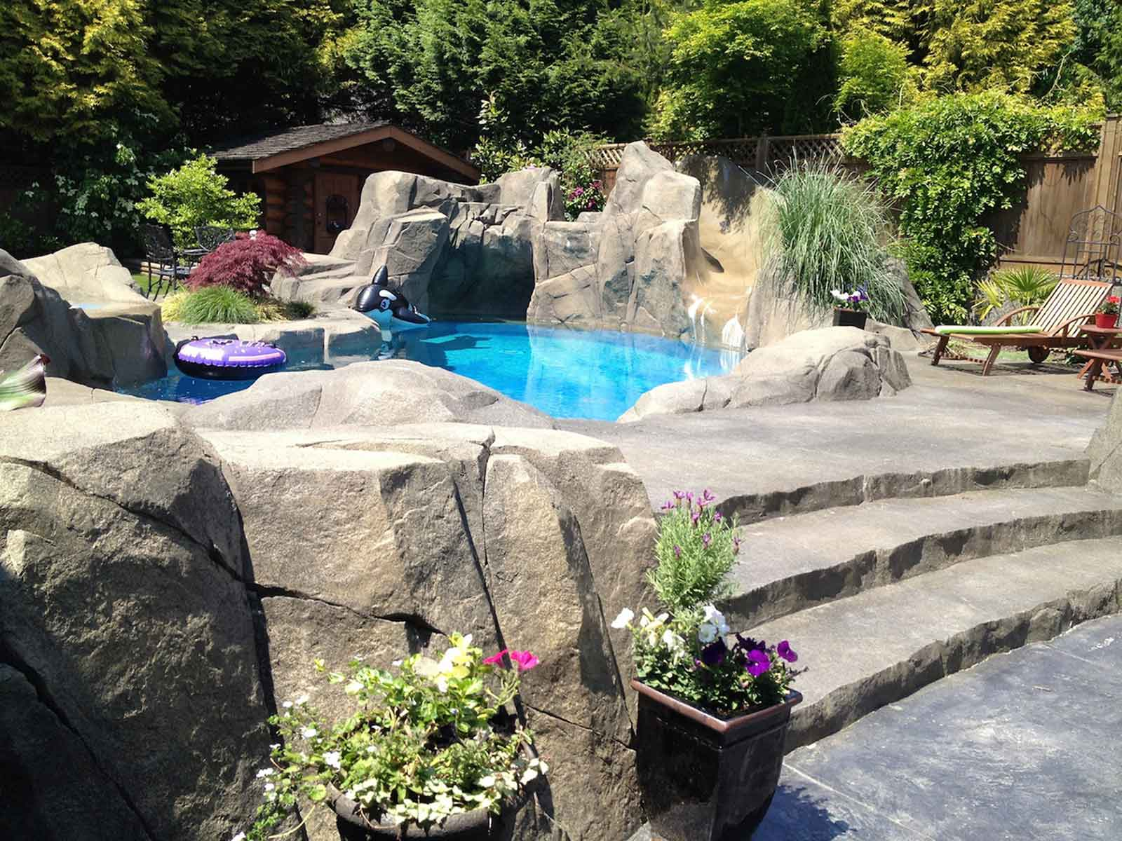 Custom artificial rock work and concrete patio
