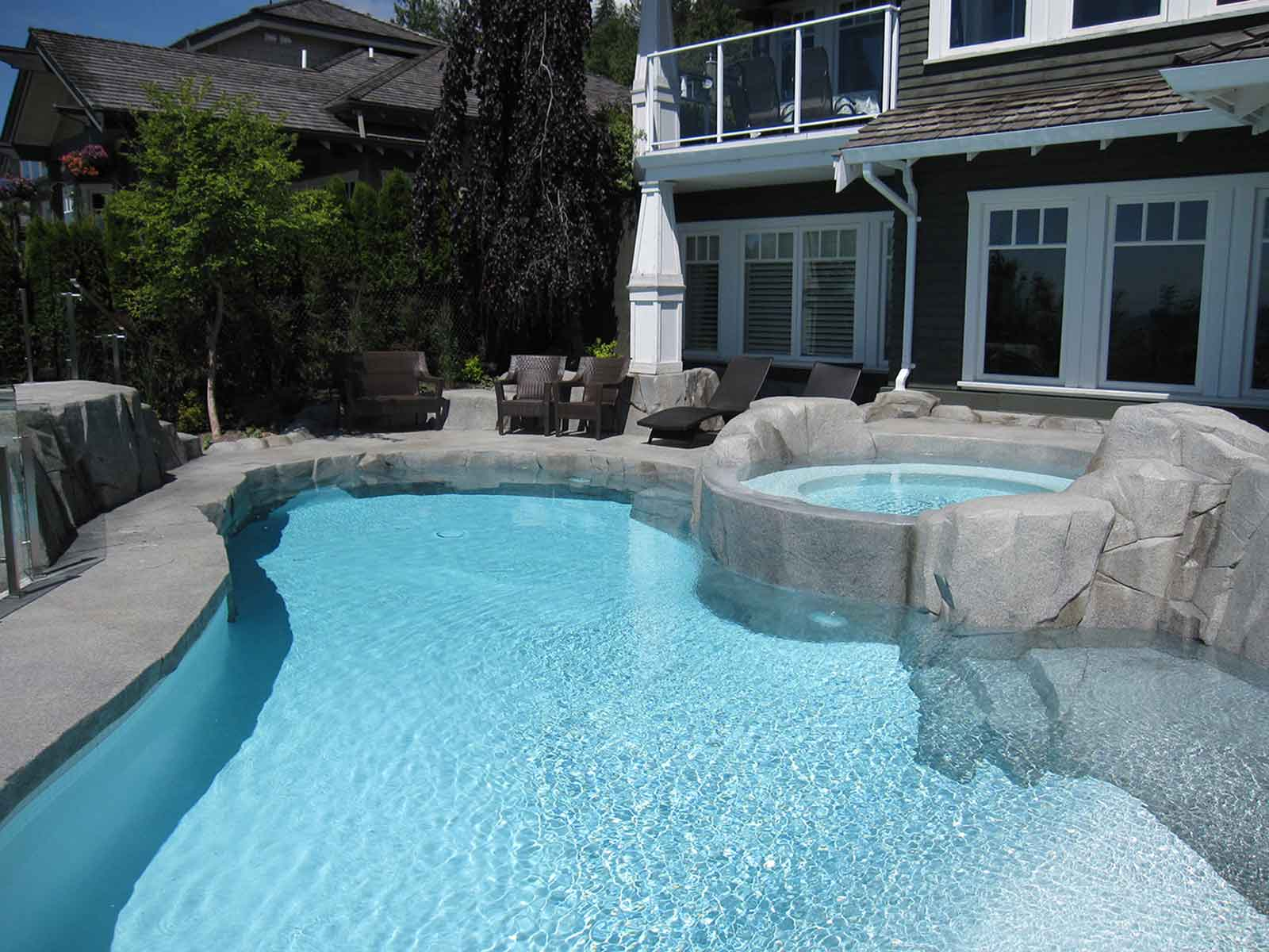 Custom concrete hot tub and swimming pool