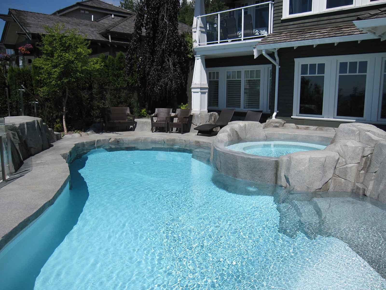 Custom concrete hot tub and swimming pool