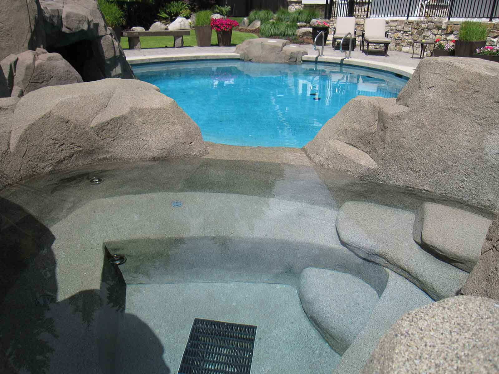 Custom concrete in-ground hot tub