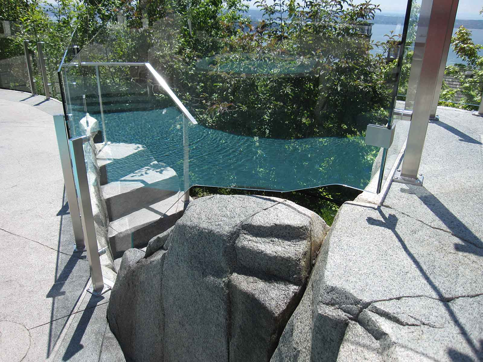 Custom concrete work in spacious backyard