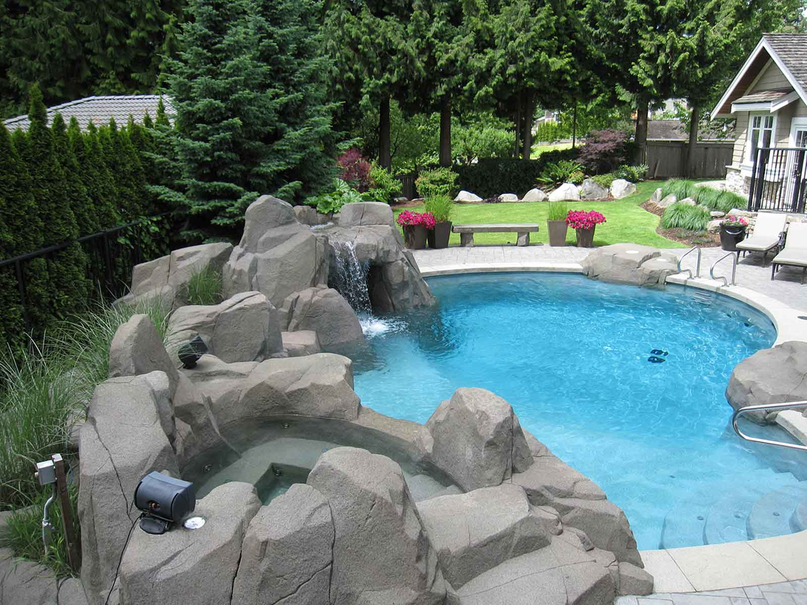 custom designed artificial rock work and in-ground swimming pool