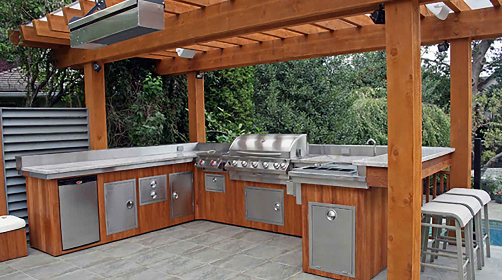 Custom outdoor kitchen with built-in appliances