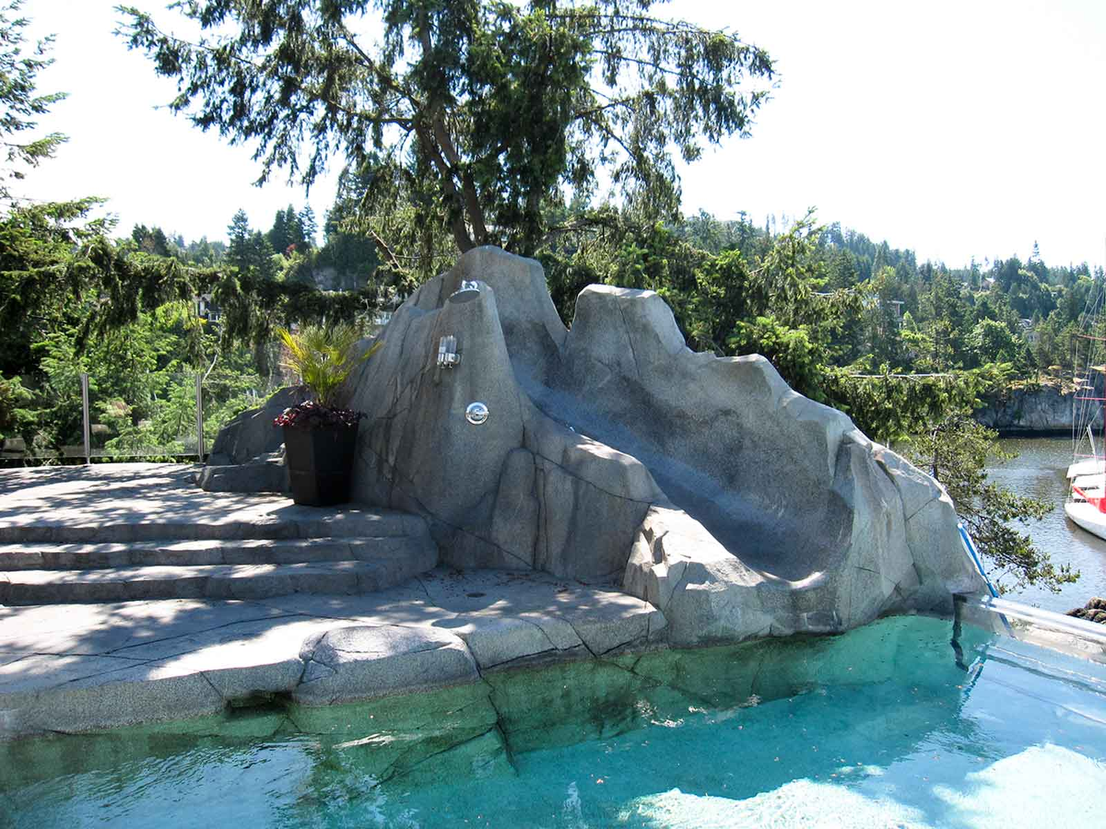 Outdoor custom shower with artificial rock wall