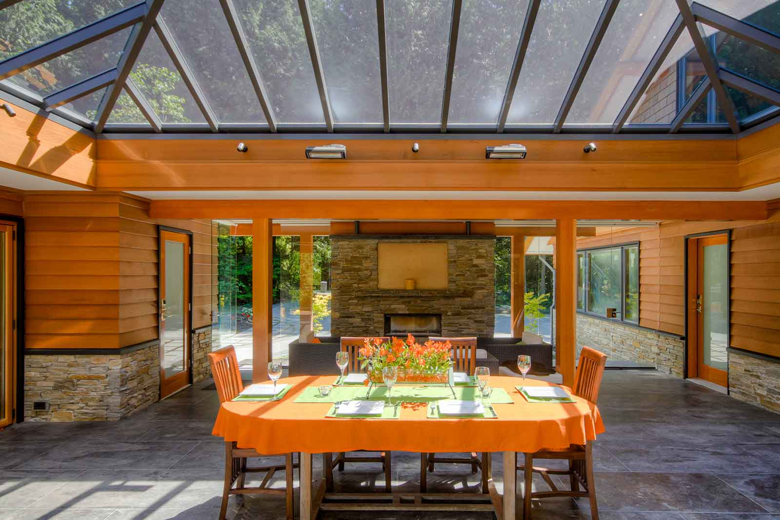 Covered outdoor dining area with wood beams