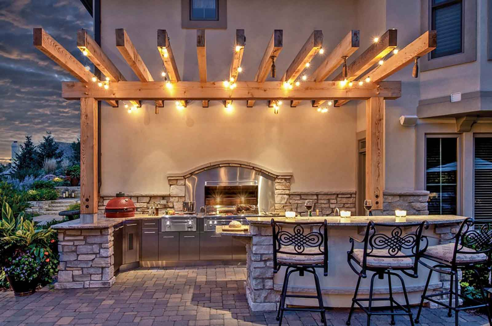 Outdoor kitchen at night with lighting