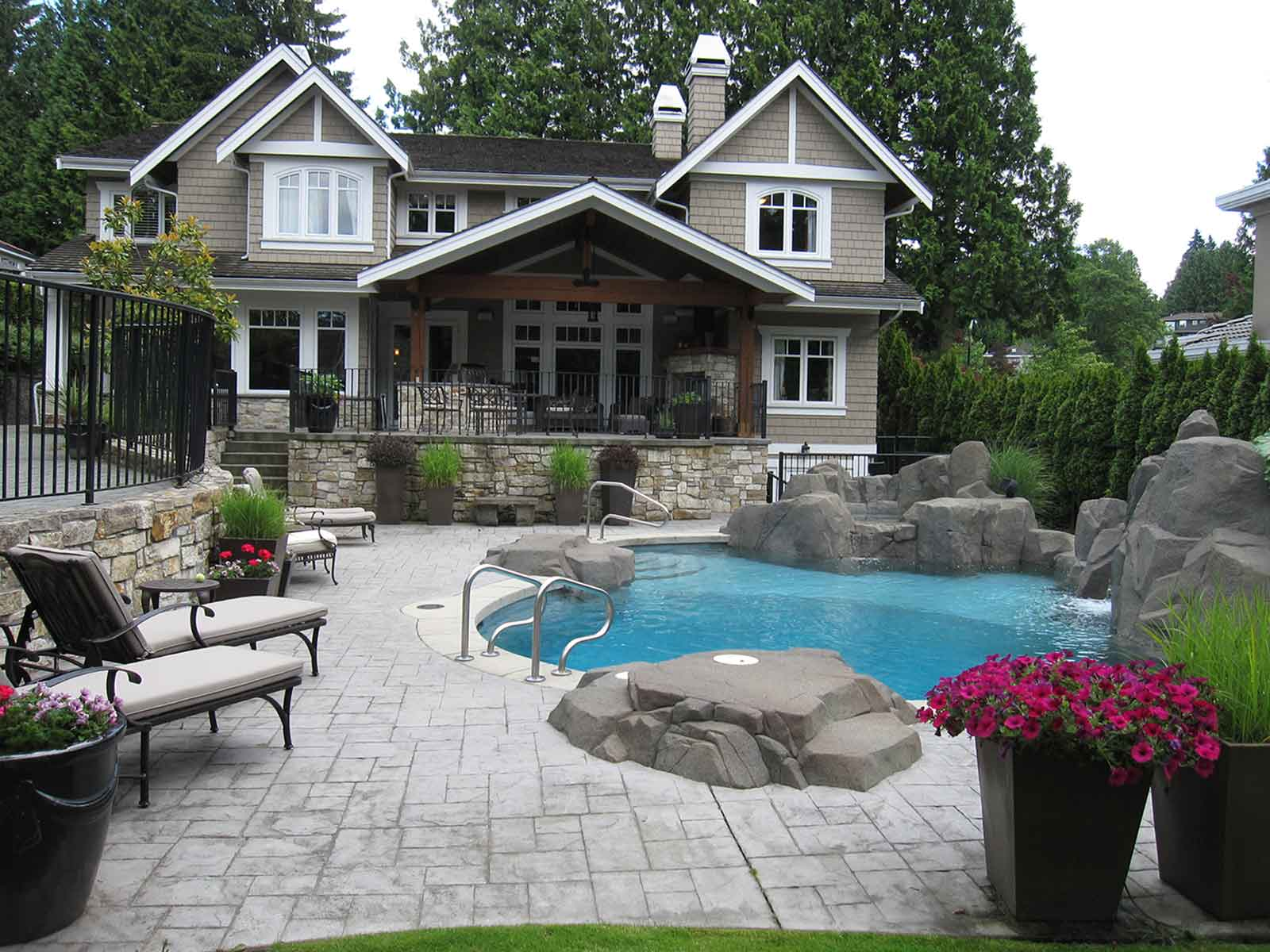 In-ground swimming pool with patio