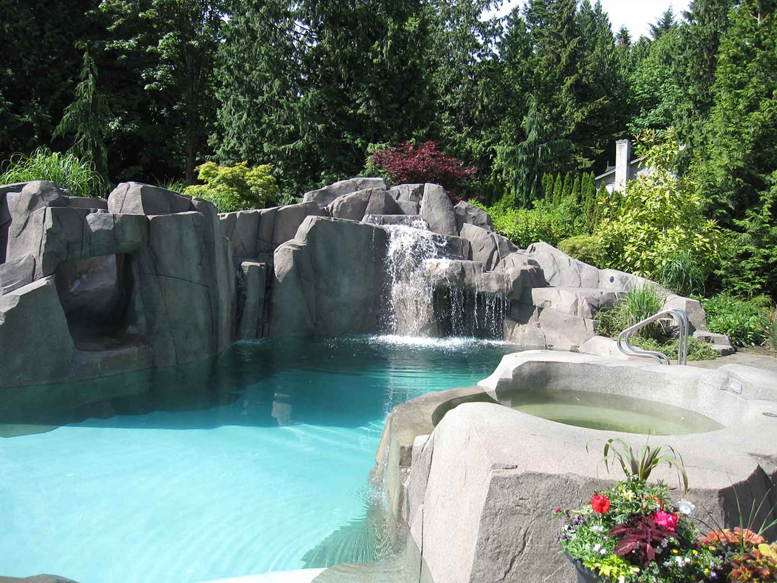 Spectacular outdoor swimming pool with artificial rock walls