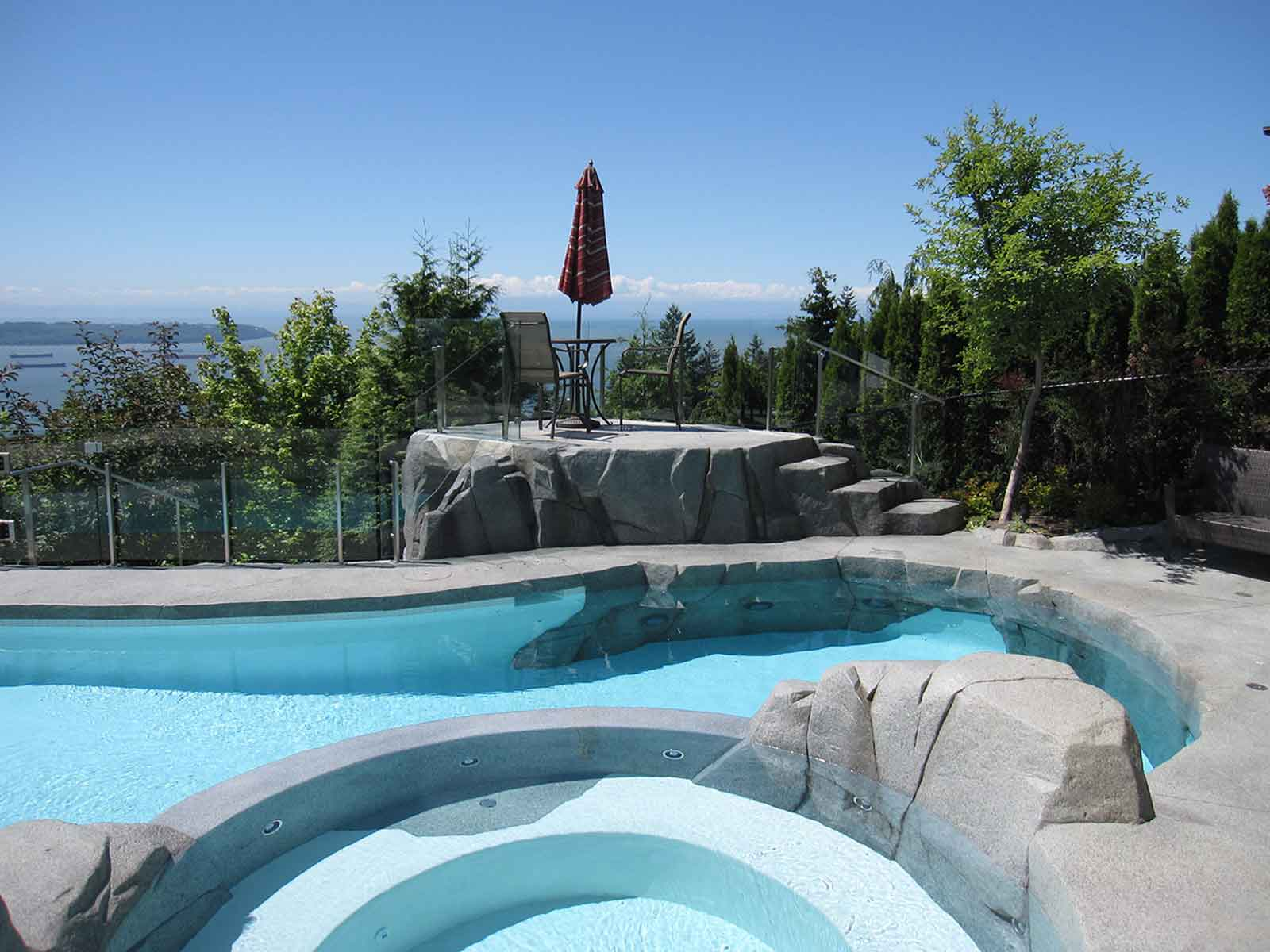 Contemporary design for in-ground swimming pool and hot tub