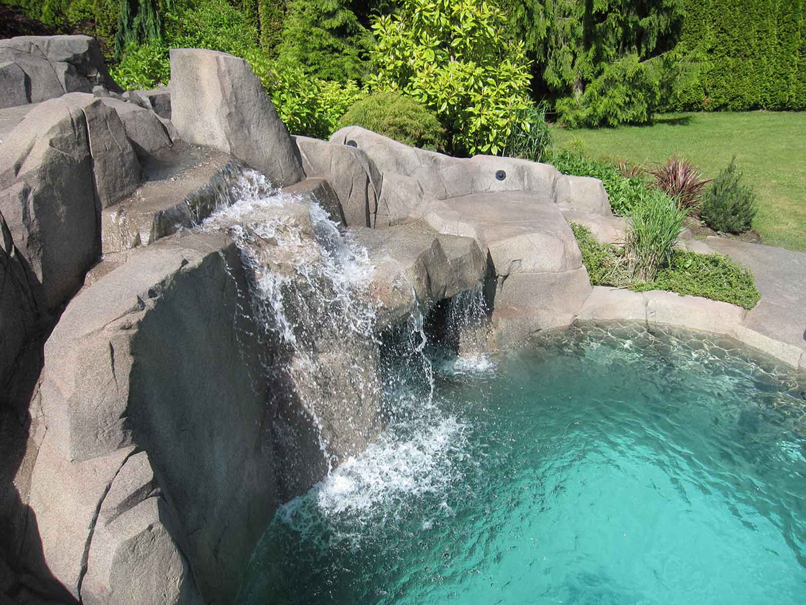 Custom designed waterfall into inground swimming pool