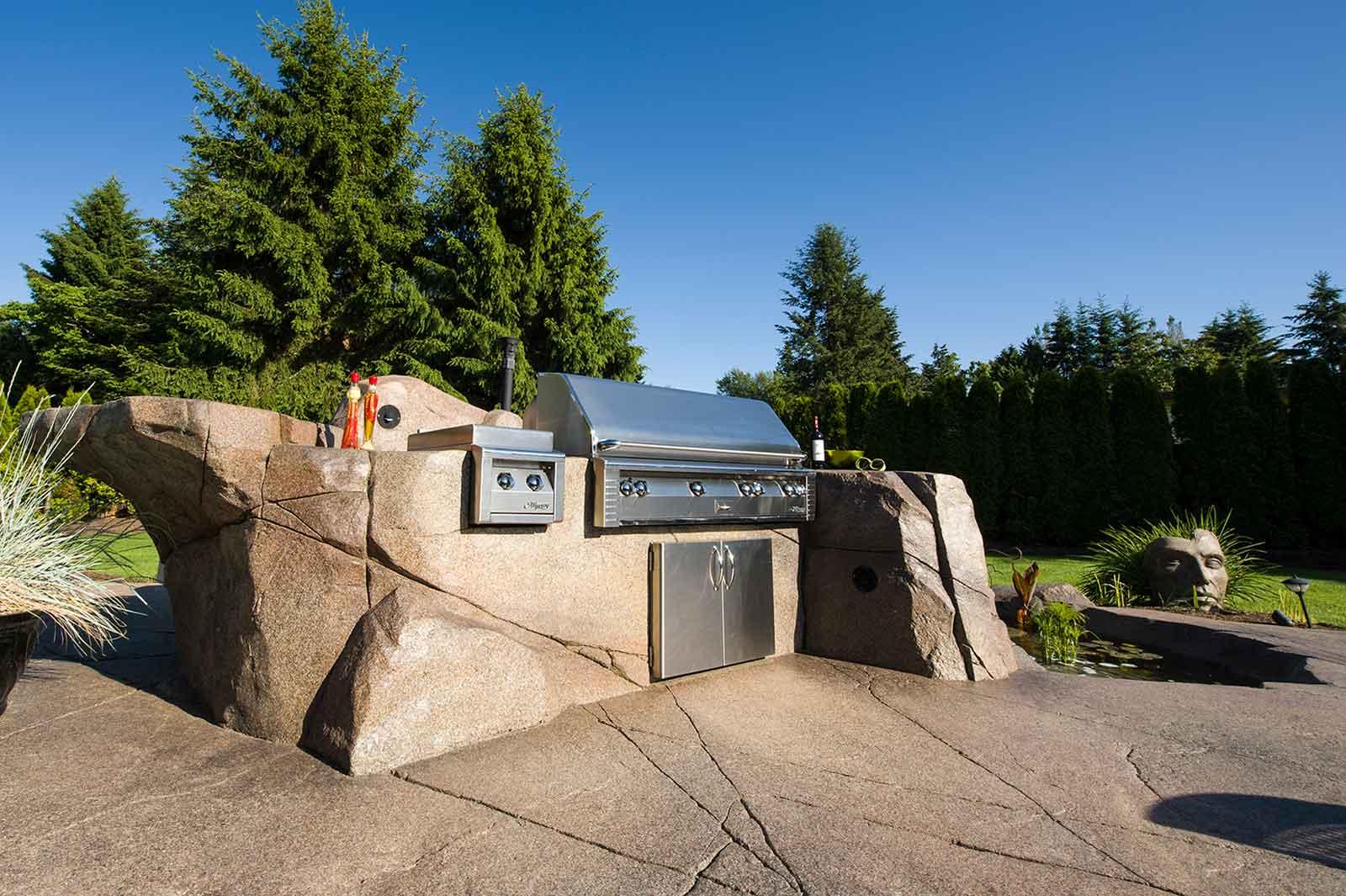 Custom concrete paving around built-in outdoor barbeque