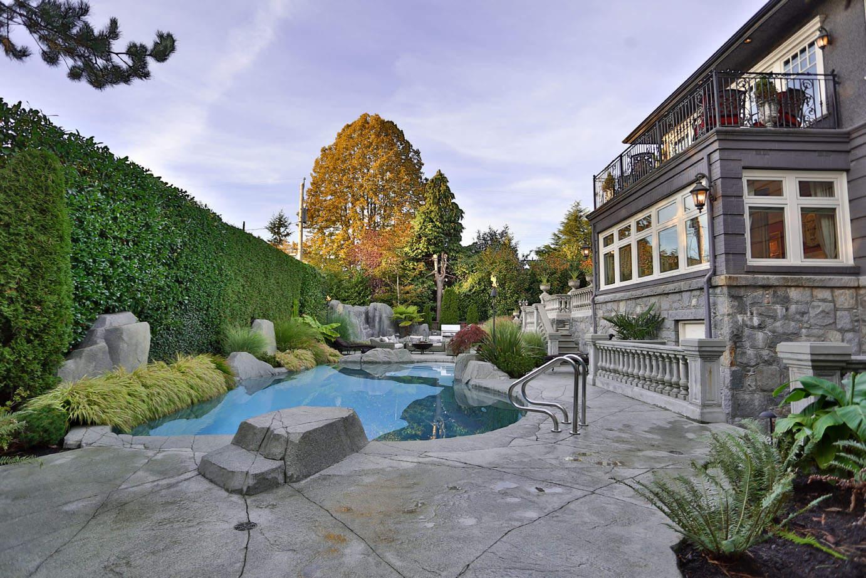 Backyard design with custom concrete patio pool deck