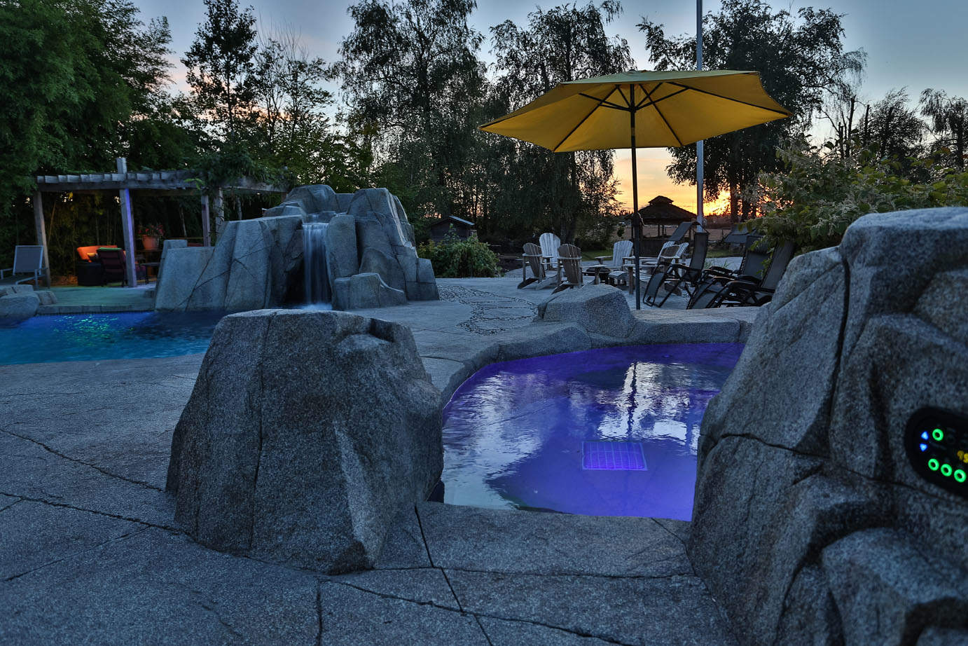 Backyard makeover with custom rock work and lighting