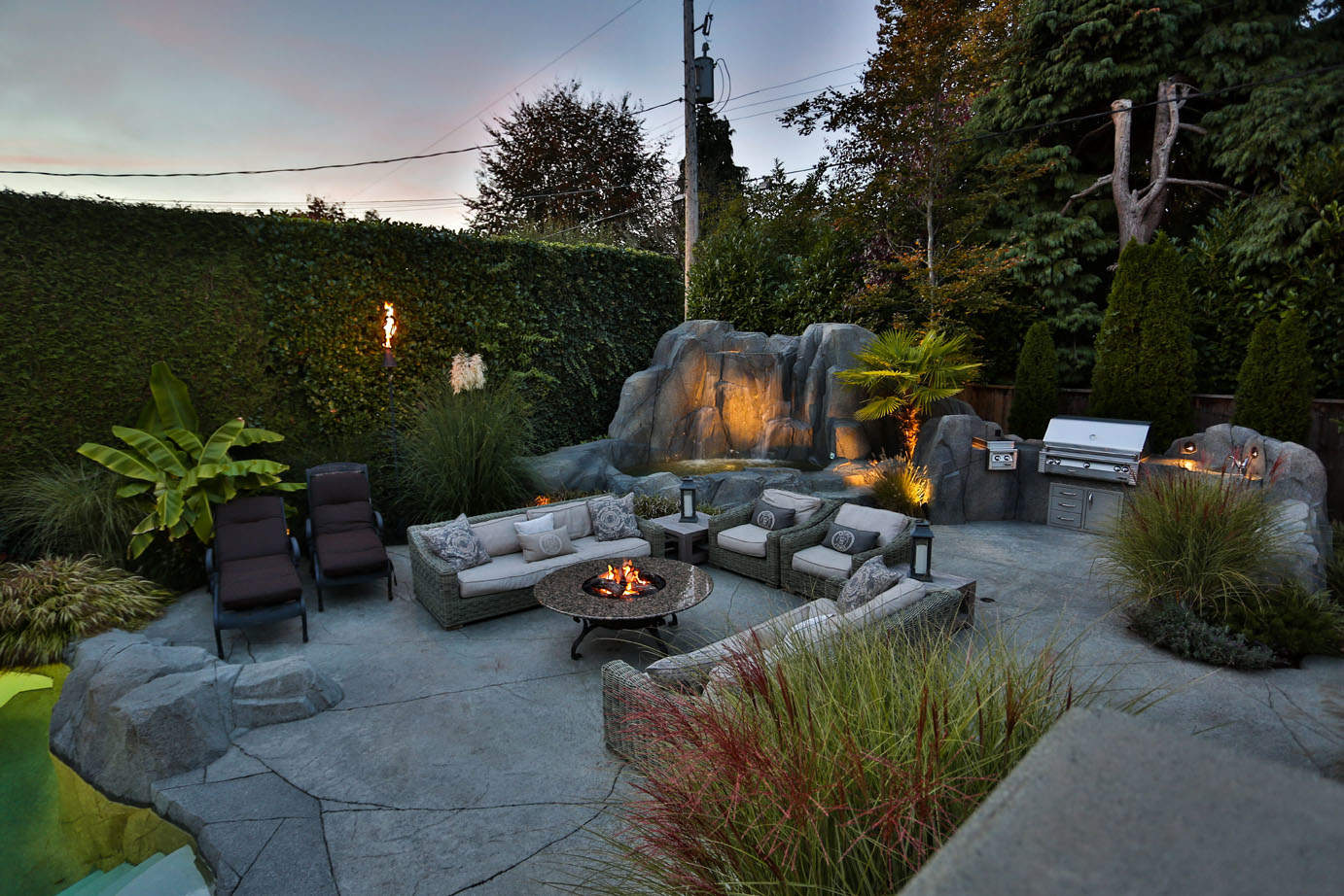 Beautiful outdoor patio with custom concrete work and fire pit