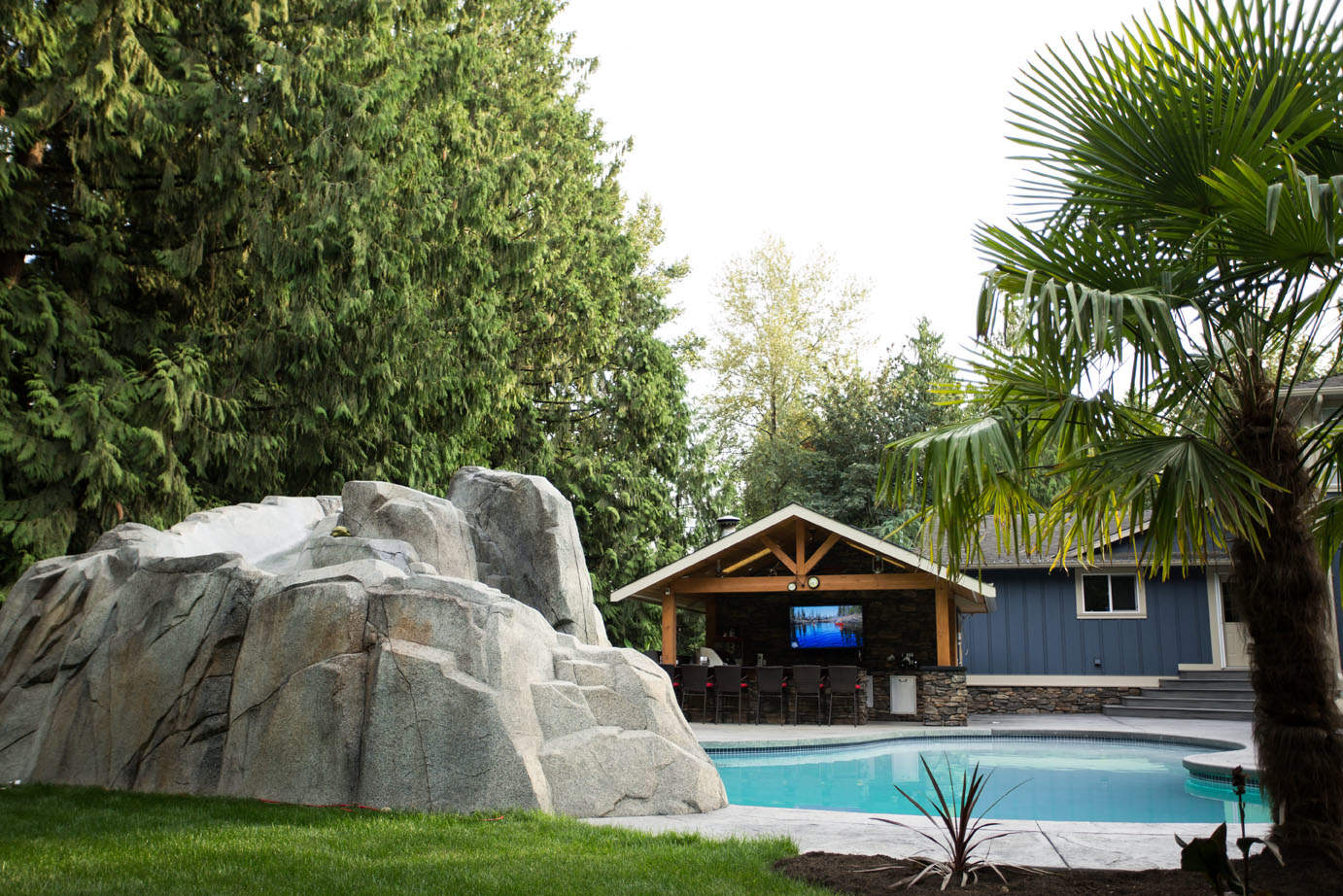 Custom artificial rock work outdoor with swimming pool