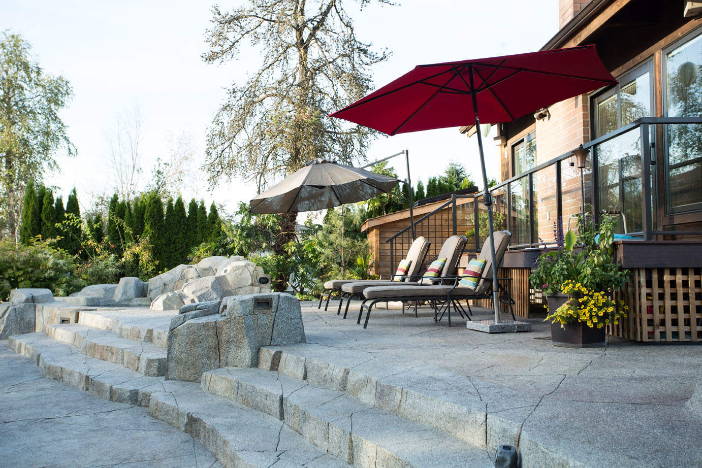 Gorgeous backyard makeover with custom concrete patio and stairs