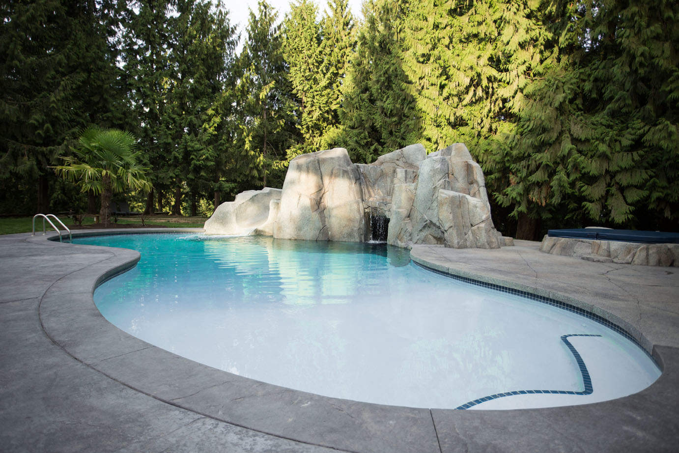 Custom designed swimming pool with high quality concrete work
