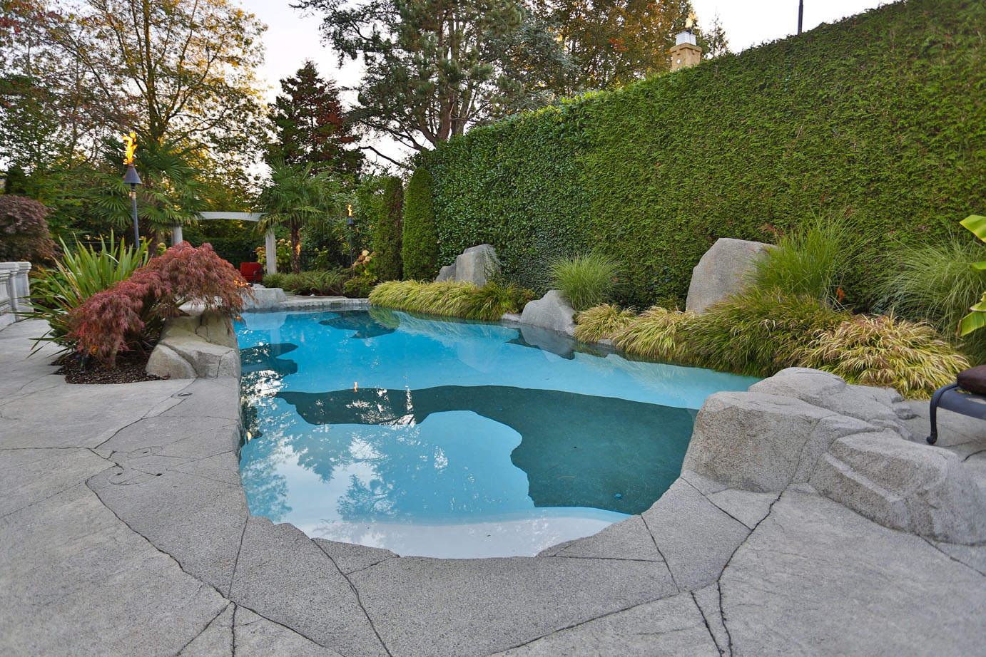 Custom designed swimming pool with unique concrete surround rock work