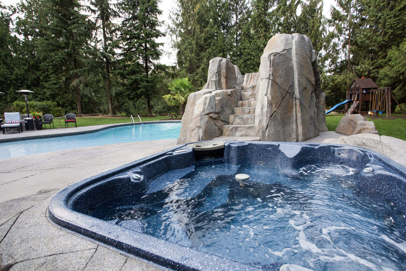Hot tub with custom concrete work