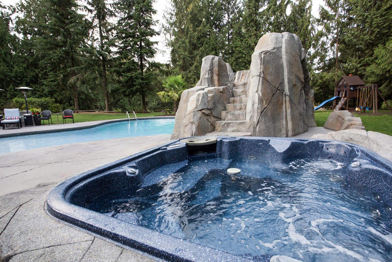 Hot tub with custom concrete work