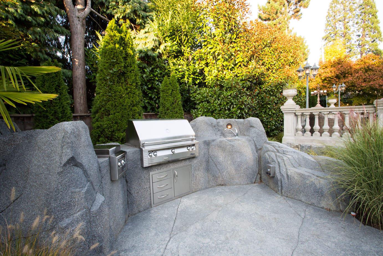 Outdoor stainless still kitchen with custom concrete work