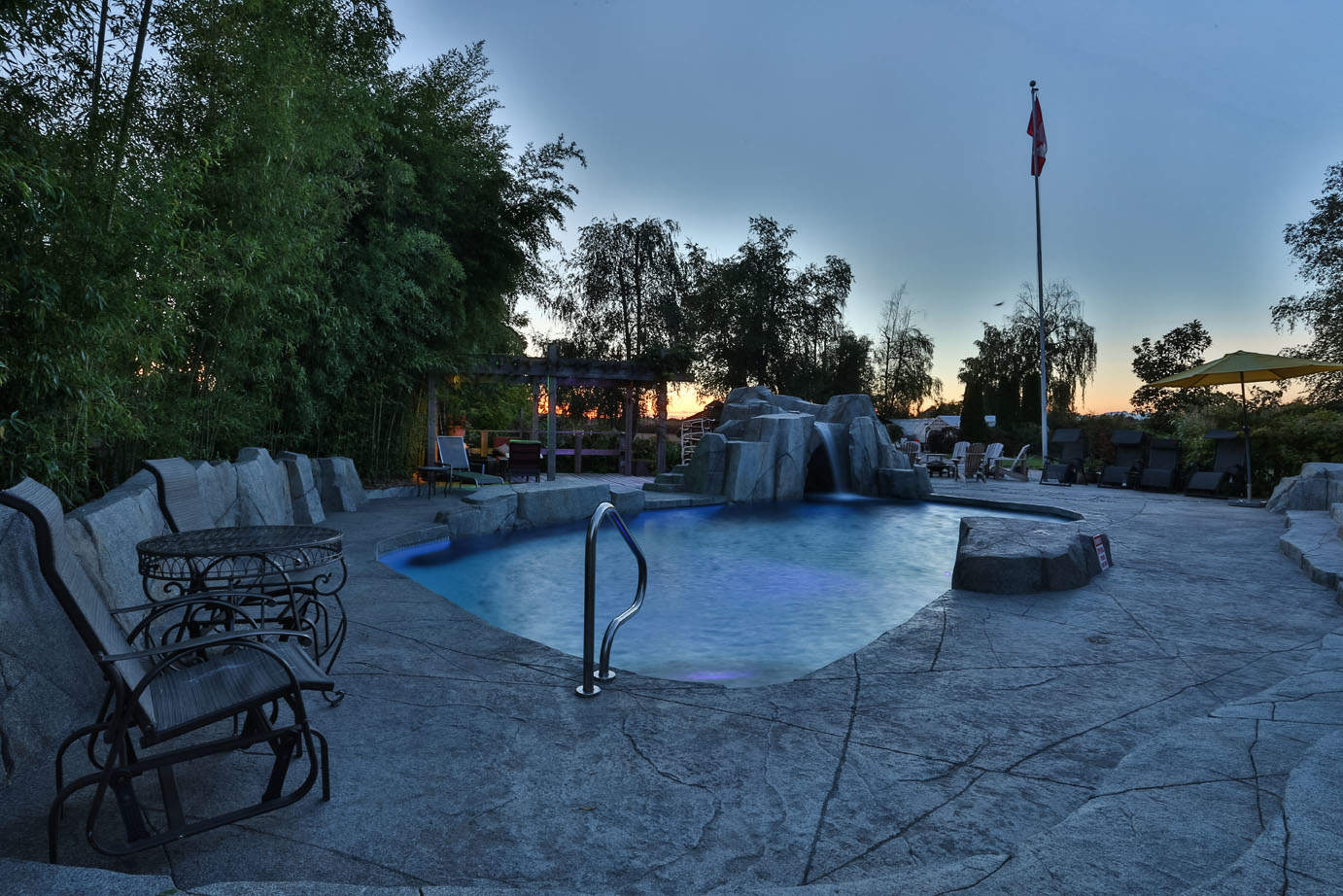 Beautiful custom in-ground concrete swimming pool