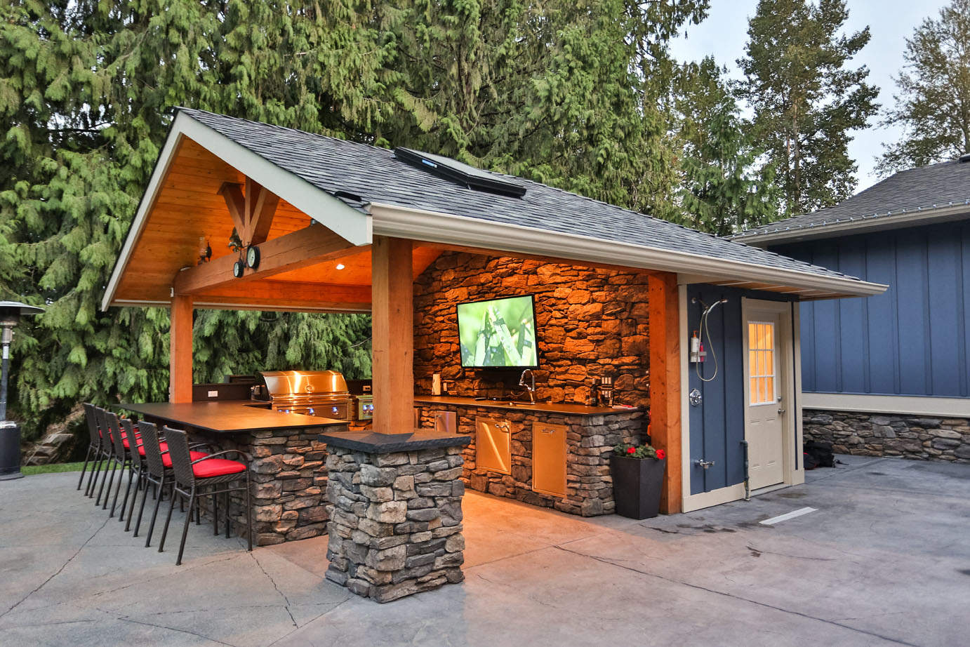 Year-round outdoor kitchen with stainless steel appliances