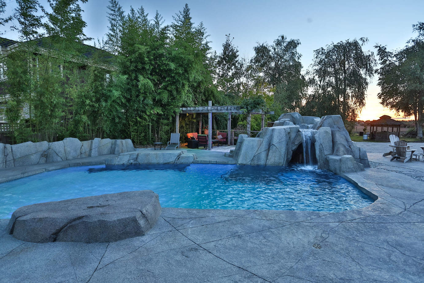High strength custom concrete rock work with pool and waterfalls