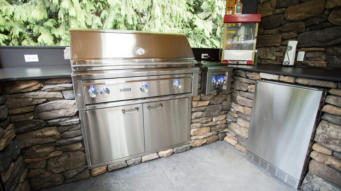 Outdoor kitchen with built-in stainless steel barbeque