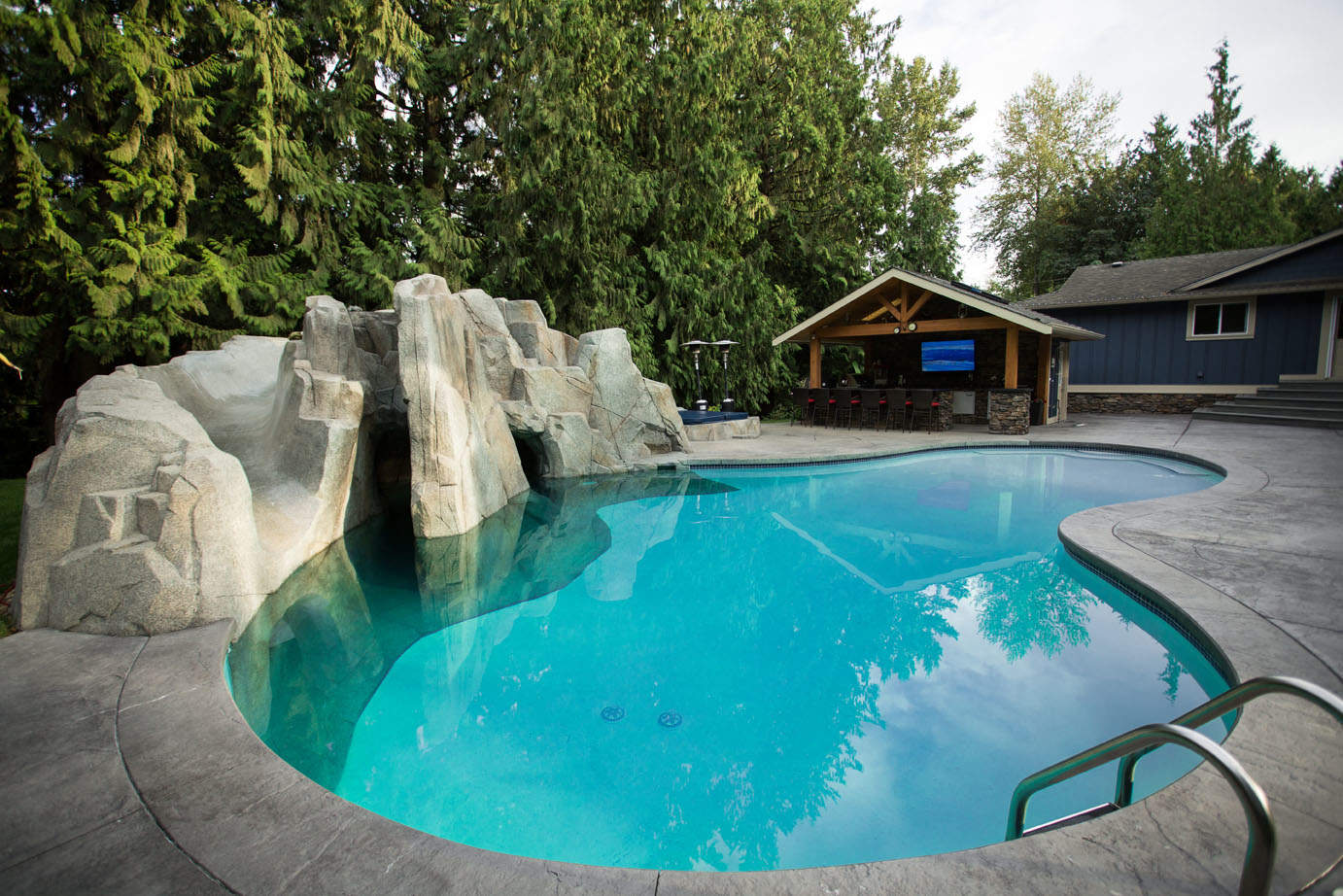 Top quality energy efficient swimming pool featuring artificial rock work